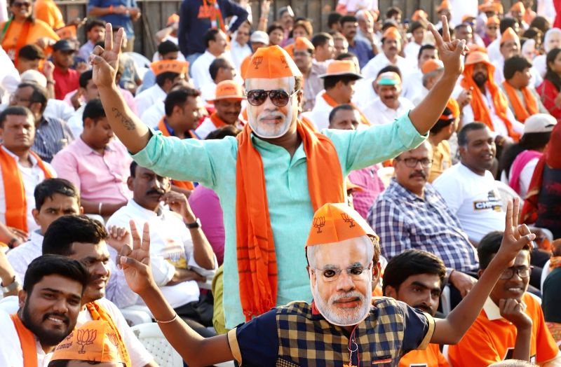 Bengaluru: BJP supporters during a party rally at Palace Grounds, in Bengaluru on April 13, 2019.