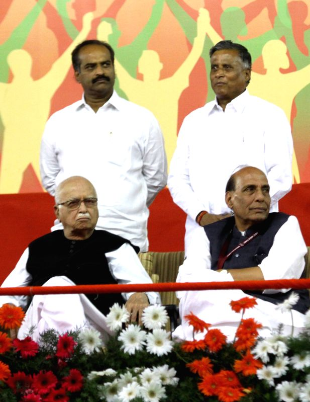 BJP veteran L K Advani and Union Home Minister Rajnath Singh during a public meeting in Bengaluru, on April 3, 2015. - Rajnath Singh and L K Advani