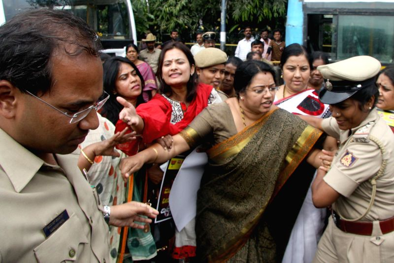 BJP women wing activists demonstrating against Karnataka government's failure to curb crime against women being taken away by police in Bengaluru, on Dec 2, 2014.