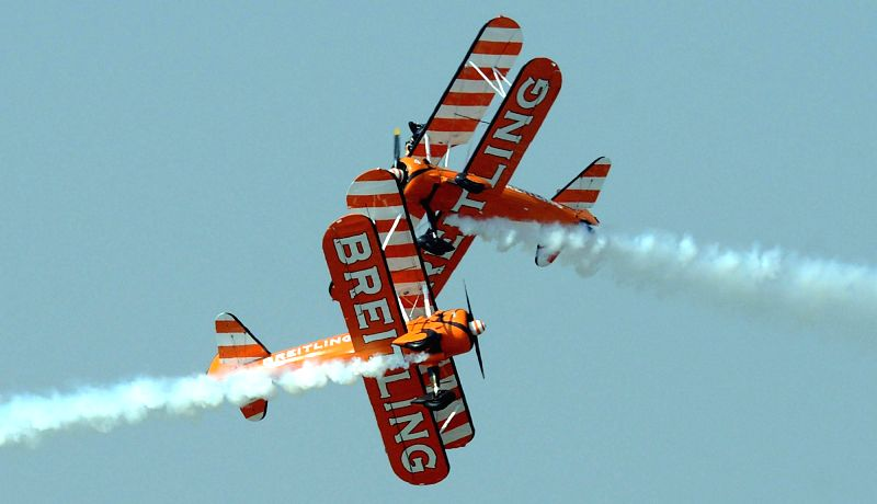 Breitling Wingwalkers aircrafts perform aerobatics during the Aero India-2015 Air Show, at Yelahanka Air-force Station, in Bengaluru on Feb 21, 2015.