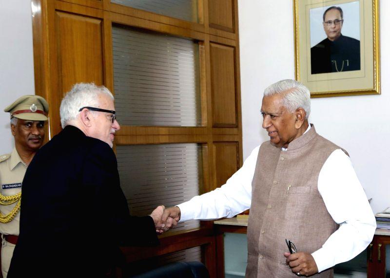 Canada's Consul General in Bengaluru Sidney Frank calls on Karnataka Governor Vajubhai Rudabhai Vala in Bengaluru, on April 9, 2015.
