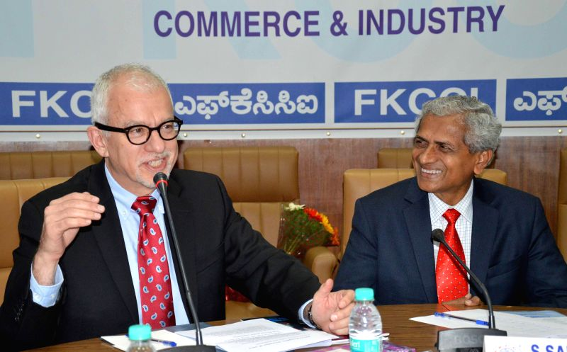 Canada's first Consul General in Bengaluru Sidney Frank with FKCCI chief S Sampathraman during a meeting in Bengaluru, on Feb 10, 2015.