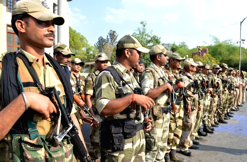 Bengaluru: Central Industrial Security Force (CISF) personnel conduct a flag march ahead of 2019 Lok Sabha elections, in Bengaluru on April 5, 2019.