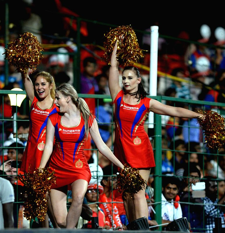 Cheerleaders perform during an IPL-2015 match between Royal Challengers Bangalore and Mumbai Indians at M Chinnaswamy Stadium, in Bengaluru, on April 19, 2015.