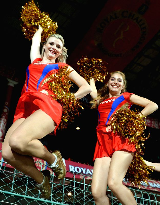 Cheerleaders perform during an IPL-2015 match between Royal Challengers Bangalore and Chennai Super Kings at M Chinnaswamy Stadium, in Bengaluru, on April 22, 2015.