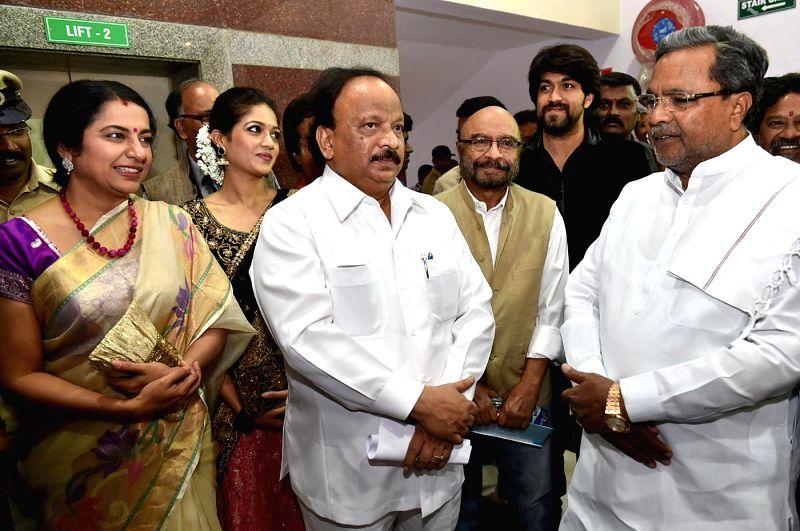 Chief Minister Karnataka Siddaramaiah during the inauguratation of the 7th Bengaluru International Film Festival, at Dr BR Ambedkar Bhavan, in Bengaluru on Dec 5, 2014. Also seen Karnataka - Karnataka Siddaramaiah and Roshan Baig