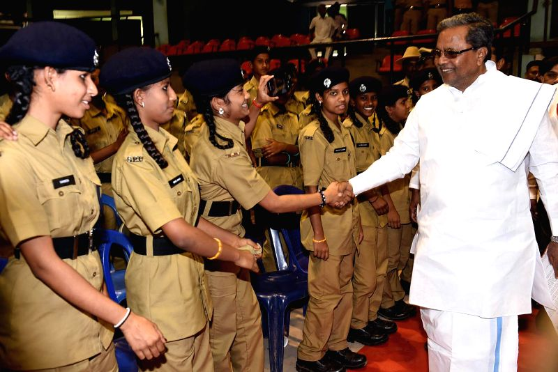 Chief Minister Siddaramaiah being welcomed by NCC cadets during a programme at Kanteerava indoor stadium, in Bangalore on March 2, 2015.
