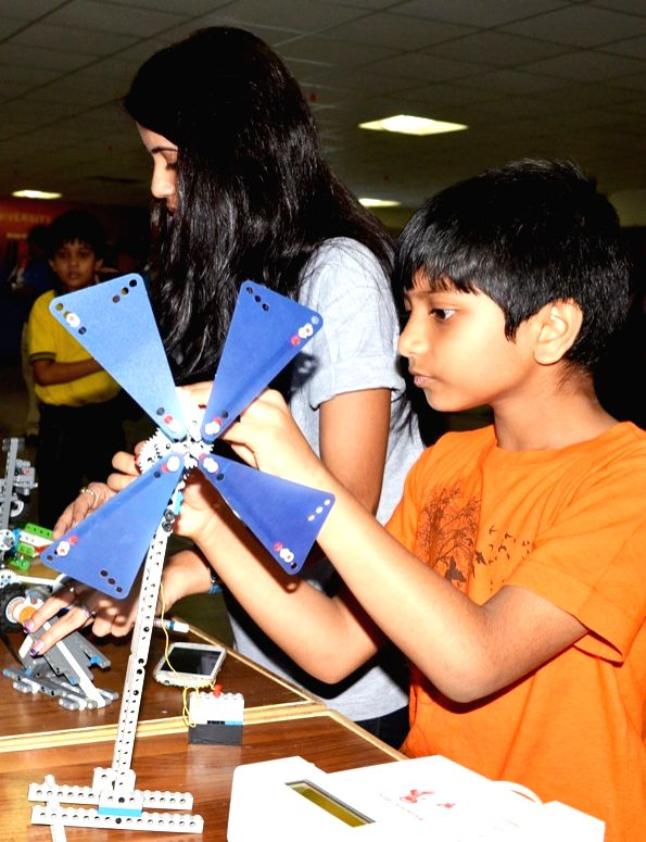 Children busy building robots during the ROBOFEST2015 at Jain College in Bengaluru on April 12, 2015.