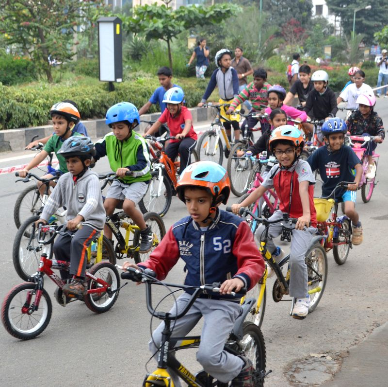 Children participate in a cyclothon organised on World Energy Saving Day organised in Bengaluru, on Dec 14, 2014.