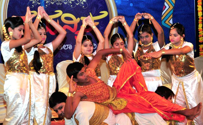 Children perform during the inauguration of `Samanvitha` a cultural programme organised at Janaseva Kala Trust, in Bengaluru on Feb 25, 2015.