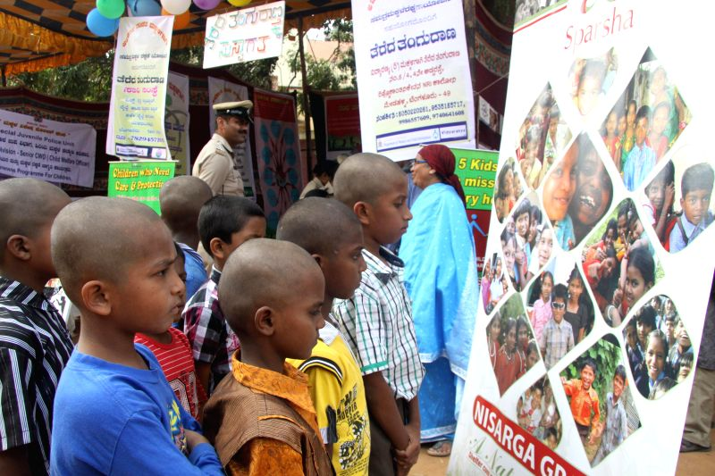 Childrens visits the stalls during the Awareness on Children Safety Mela organised by Woman and Child Development Department, at Bannappa Park, in Bengaluru on Nov 29, 2014.