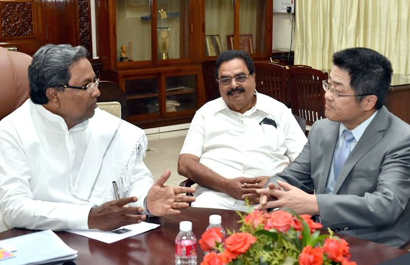 China Ambassodar Le Yucheng calls on Karnataka Chief Minister Siddaramaiaha at Vidhana Soudha, in Bengaluru on Feb. 4, 2015. Also seen Forest Minister Ramanath Rai. - Siddaramaiaha and Ramanath Rai