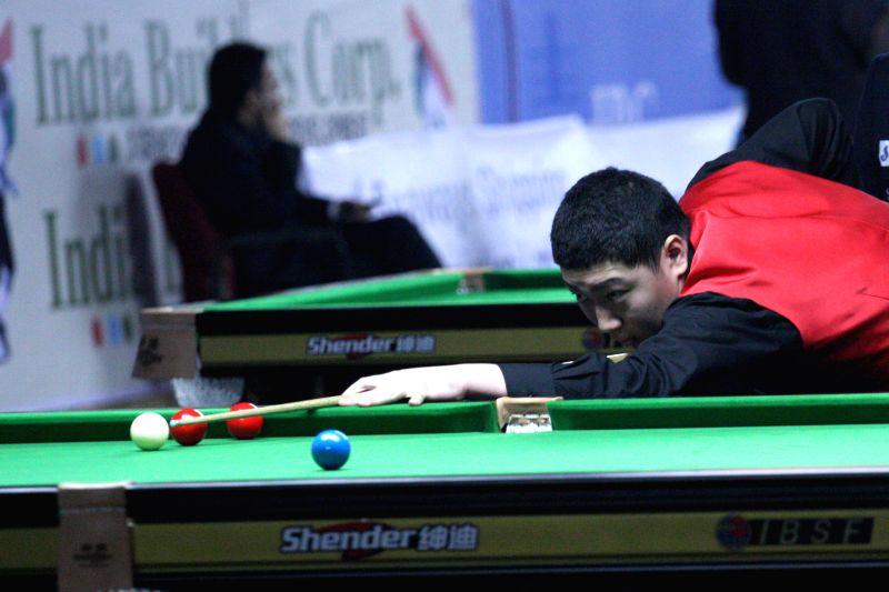 China player Yan Bingtao in action during IBSF World Snooker Championships at Kanteerava Stadium, in Bengaluru on Nov. 28, 2014.