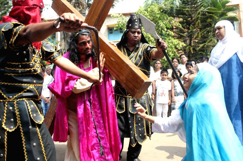 Christians participate in a procession organised on Good Friday at the Immaculate Conception Church in Bengaluru, on April 3, 2015.