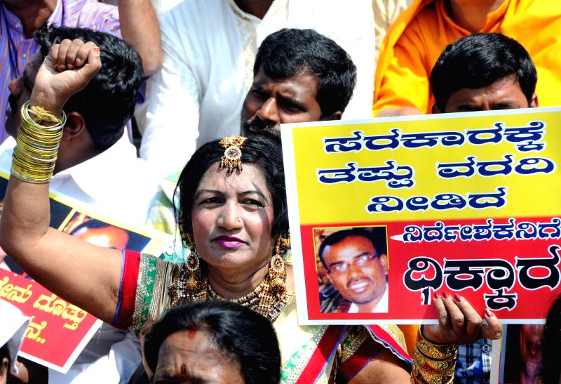 Cinema artists, writers and cultural activists stage a demonstration to press for their various demands in Bengaluru, on Nov 26, 2014.