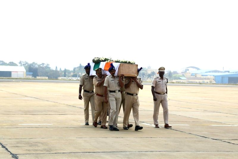 Bengaluru: Coffin of Guru H, who was among the 49 CRPF personnel killed 14 Feb Pulwama militant attack arrives in Bengaluru on Feb 16, 2019. (Photo: IANS)