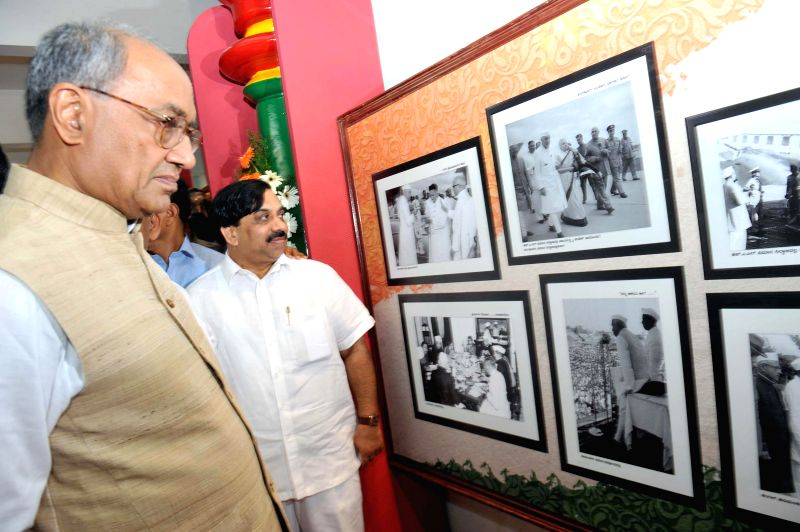 Congress leader Digvijay Singh during an exhibition on 125th birth anniversary of Former Prime Minister Jawaharlal Nehru in Bengaluru on Feb 21, 2015. Also seen AICC General Secretary and ... - Digvijay Singh