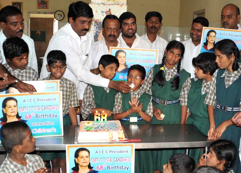 Congress workers celebrate the 68th birthday of Congress chief Sonia Gandhi in Bengaluru, on Dec 9, 2014.