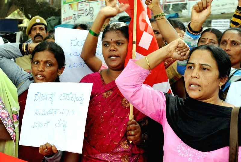 ​D​alit midday meal workers​ affiliated to CITU​ stage a protest against ​atrocities ​​on dalit midday meal ​workers​, in Benagluru on Dec 9, 2014.