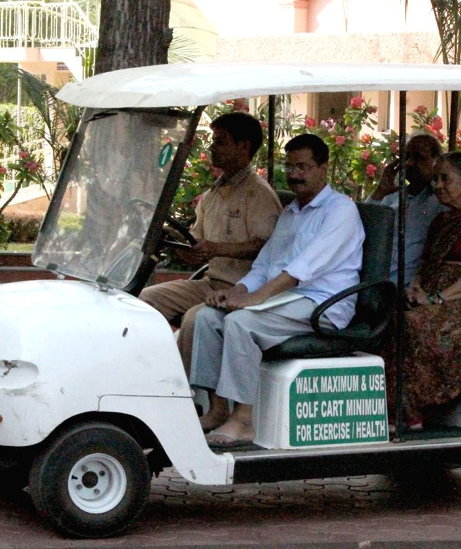 Delhi Chief Minister Arvind Kejrival with his parents G K Kejriwal and Geeta Devi arrive at Jindal Naturecure Institute for treatment, in Bengaluru on March 5, 2015. - Arvind Kejrival and G K Kejriwal