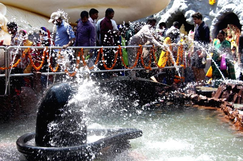 Devotees worship lord Shiva  on Mahashivratri at a Shiva temple of Bengaluru, on Feb 17, 2015.