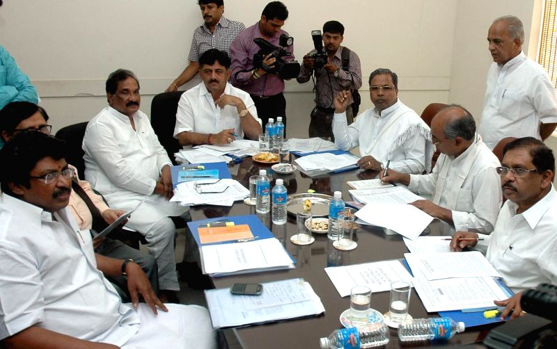 Digvijay Singh , AICC General secretary in Charge  of Karnataka  chairing Congress Co-ordination committee meeting to discuss key issues concerning the government and  the party in the ... - K J George and Digvijay Singh