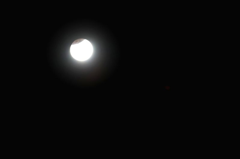 :Bengaluru: Earth's shadow falls on the moon during partial lunar eclipse; as seen from Bengaluru on Jan 31, 2018. (Photo: IANS).