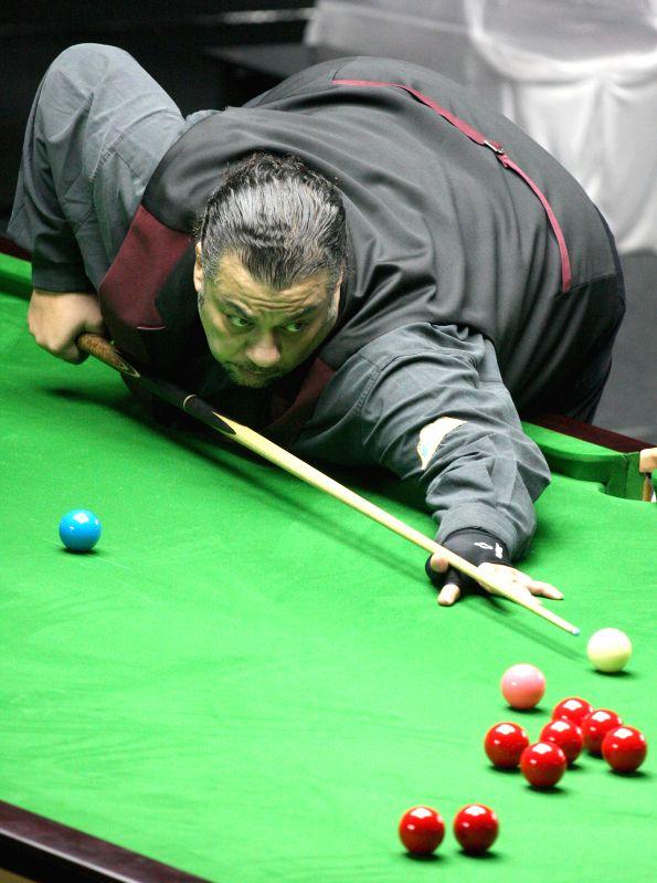 Egyptian player Wael Talaat in action during IBSF World Snooker Championships at Kanteerava Stadium, in Bengaluru on Nov. 20,  2014.