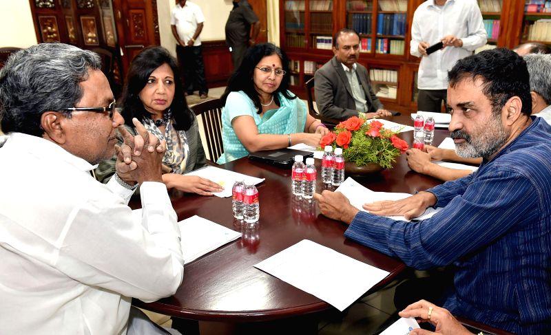 Entrepreneur Dr. Kiran Mazumdar Shaw and the chairman of Manipal Global Education T V Mohandas Pai call on Karnataka Chief Minister Siddaramaiah in Bengaluru, on Jan 14, . - Siddaramaiah