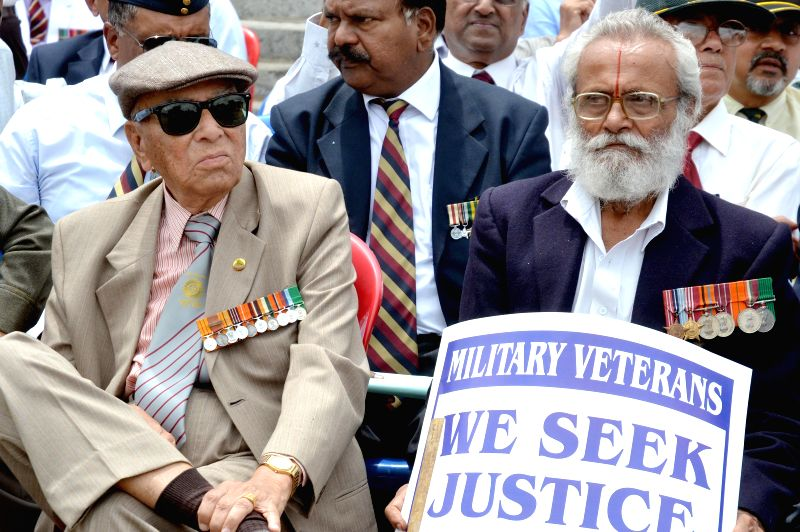 Ex-servicemen participate in a demonstration to press for `One Rank One Pension` at  in Bengaluru, on June 14, 2015.