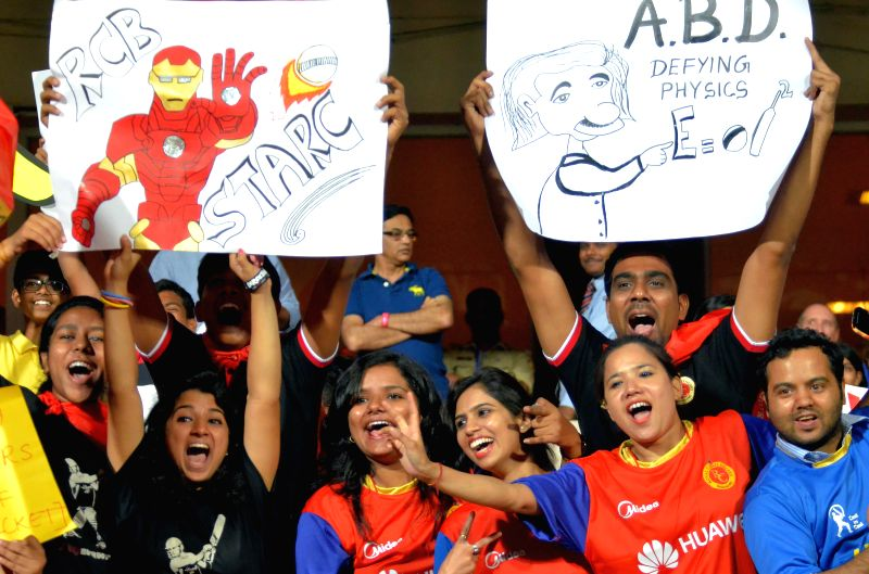 Fans cheer during an IPL-2015 match between Royal Challengers Bangalore and Rajasthan Royals at M Chinnaswamy Stadium in Bangaluru on April 29, 2015.