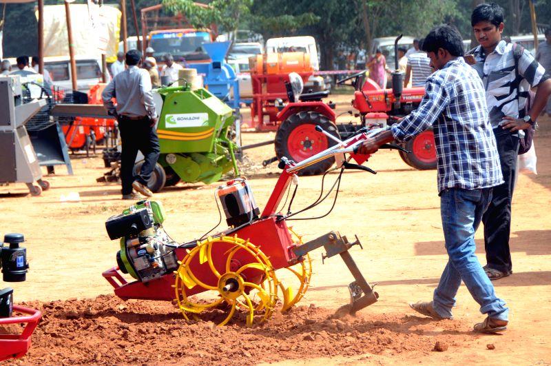 Farming equipments on display during Krishi Mela - 2014 organized by University of Agricultural Sciences at Gandhi Krishi Vignayana Kendra (GKVK), in Bengaluru on Nov. 20,  2014.