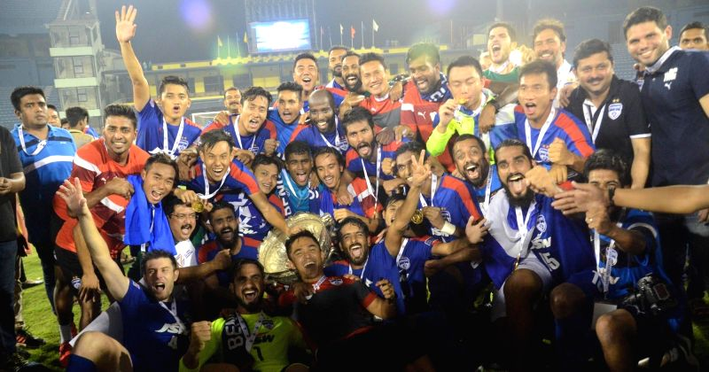 Bengaluru FC players celebrate after winning Federation Cup against Mohun Bagan at Barabati Stadium in Cuttack on May 21, 2017.