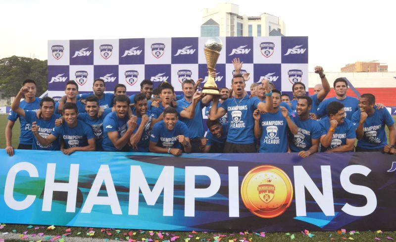 Bengaluru FC players with their I League Champions Trophy during a programme organised to celebrate their victory at Bangalore Football Stadium, in Bangalore on April 29, 2014.