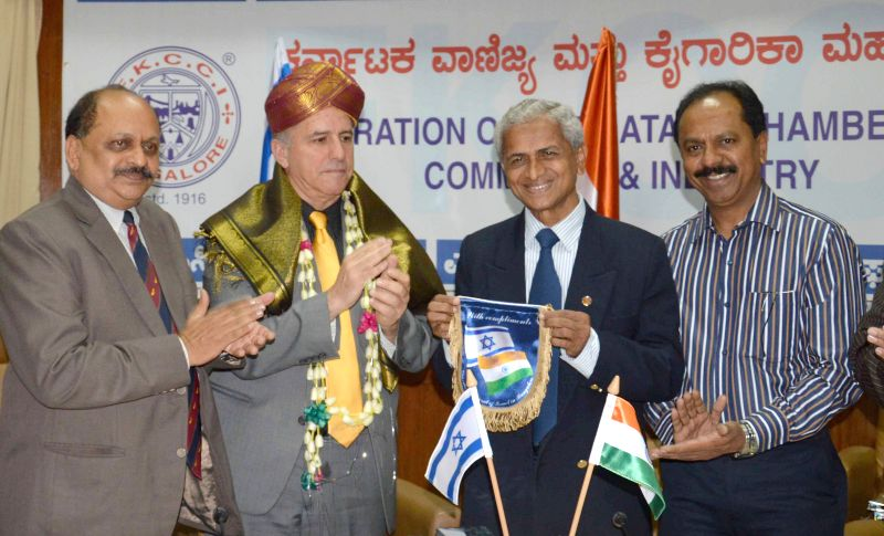 FKCCI Chairman S Sampathraman with the Ambassador of Israel in India, Daniel Carmon during an interactive session at FKCCI in Bengaluru on April 6, 2015. Also seen FKCCI Senior Vice ...