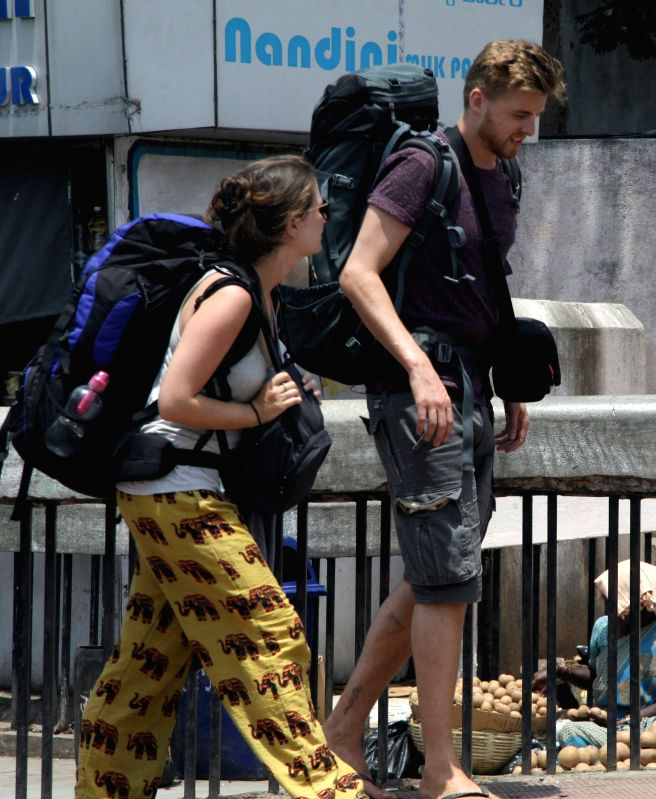 Foreign tourists stranded at a Bengaluru bus depot during a 24-hour nationwide transport strike called by trade unions on April 30, 2015.