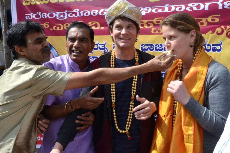 Foreigners participate in the 90th birthday celebration of former prime minister Atal Bihari Vajpayee in Bengaluru, on Dec 25, 2014.