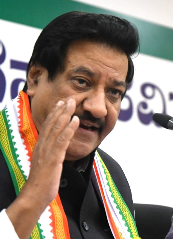 Bengaluru: Former Maharashtra Chief Minister and Congress leader Prithviraj Chavan addresses a press conference at the party office, in Bengaluru on April 28, 2018. (Photo: IANS)
