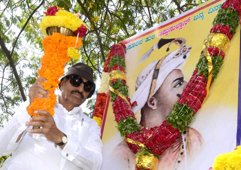 Former MLA and president of Kannada Chalavali Vatal Paksha Vatal Nagaraj pay tribute to Tippu Sultan`s portrait on the occasion of his 264 birth anniversary at Tippu Palace, in Bengaluru ..