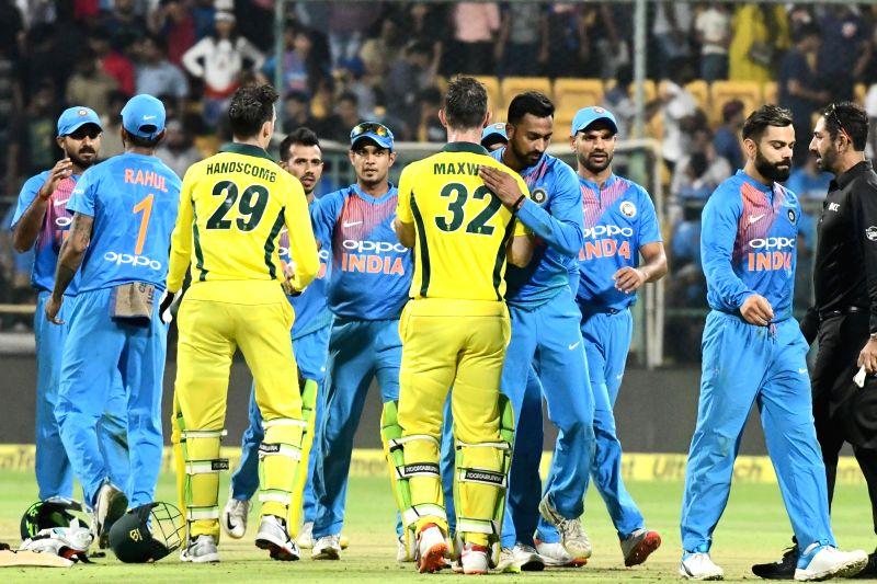 Bengaluru: Glenn Maxwell and Peter Handscomb of Australia celebrates after winning the second T20I match against India at M Chinnaswamy Stadium in Bengaluru on Feb 27, 2019. (Photo: IANS)