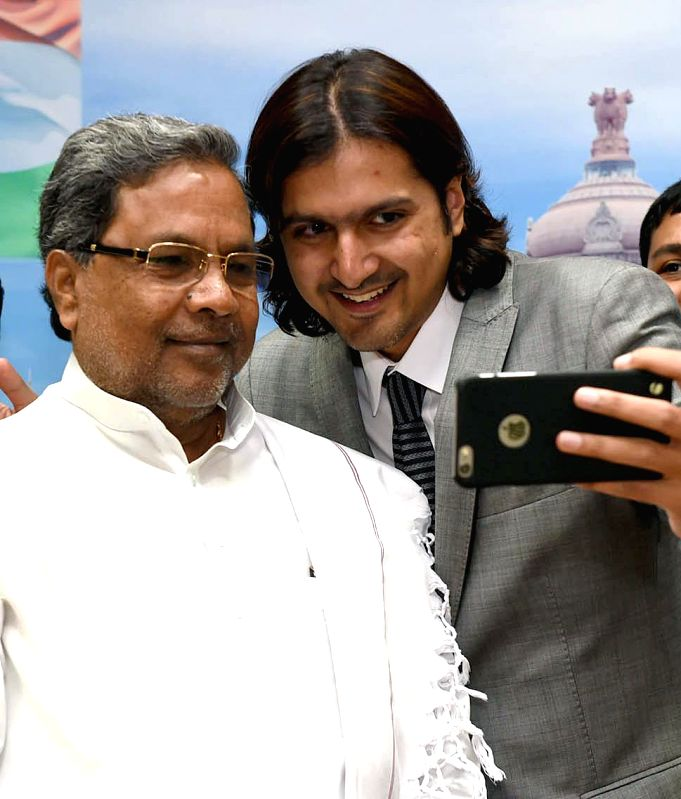 Grammy award winner Ricky Kej take`s a selfie with Karnataka Chief Minister Siddaramaiah at CM office in Bengaluru, on Feb 17, 2015. - Siddaramaiah