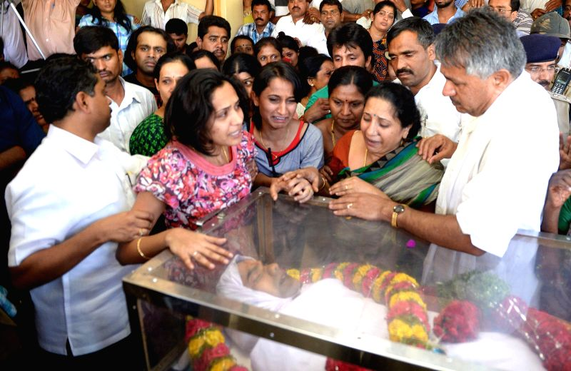 Grief struck relatives (including Kusuma the wife) of Bangalore Additional Commissioner of Commercial Taxes D K Ravi who was found dead in his apartment under mysterious circumstances, in ...