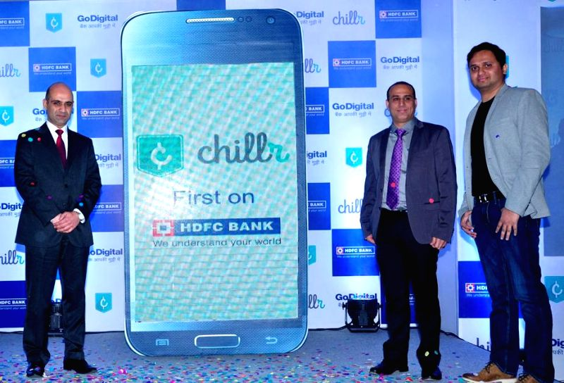 HDFC Bank Head- Digital Banking Nitin Chugh with HDFC Bank Branch Banking Head Dhiraj Relli and the Co-founder and Director of MobMe Wireless Solutions at the launch of HDFC Bank`s  ...