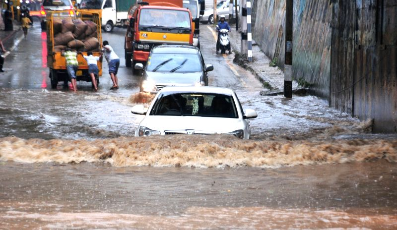 : Bengaluru: Heavy rains cause waterlogging and flooding of streets in Bengaluru on Nov. 4, 2015. (Photo: IANS).