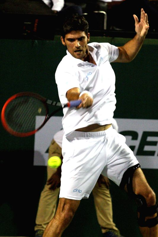 Hyderabad player Mark Philippoussis in action against Thomas Enqvist of Bangalore during a Champions Tennis League (CTL) match in Bengaluru on Nov 21, 2014.