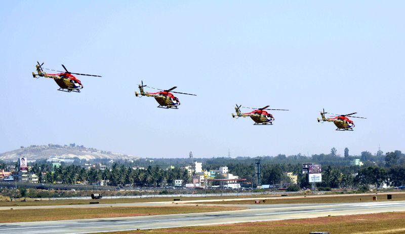 IAF aircrafts perform aerobatics during the Aero India-2015 Air Show, at Yelahanka Air-force Station, in Bengaluru on Feb 19, 2015.