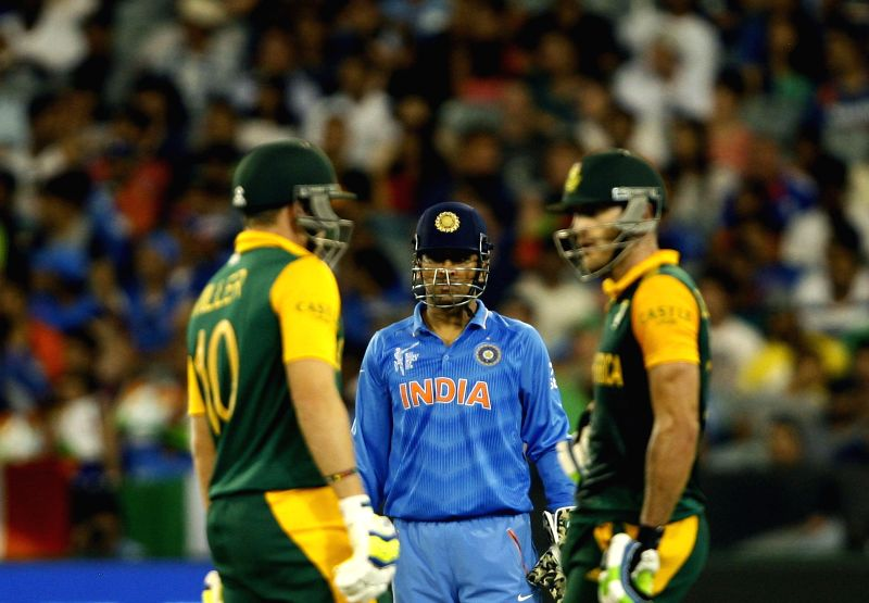 Indian captain M S Dhoni with Indian cricketers DA Miller and Faf du Plessis during an ICC World Cup 2015 match between India and South Africa at Melbourne Cricket Ground, Australia on Feb ... - M S Dhoni