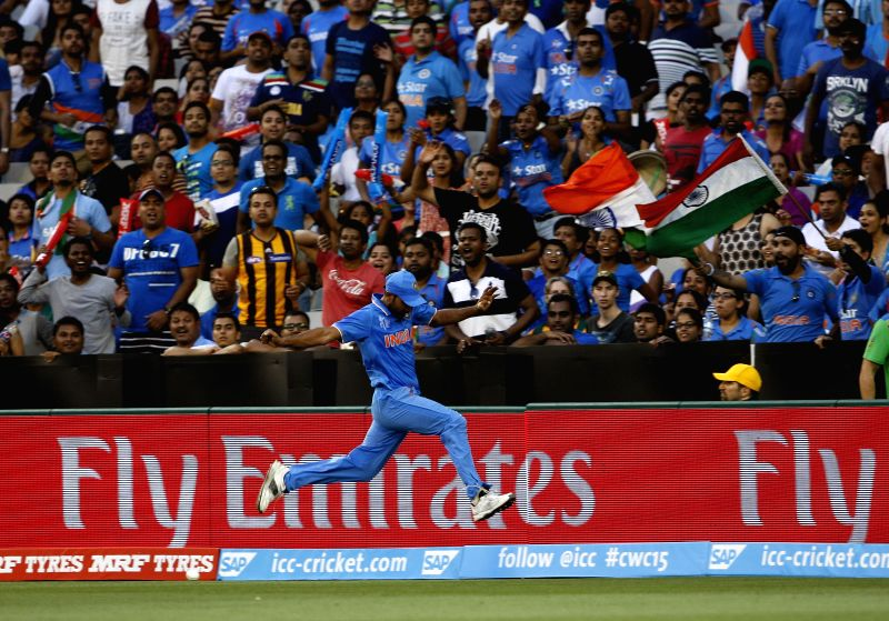 Indian cricketer Mohammed Shami  in action during an ICC World Cup 2015 match between India and South Africa at Melbourne Cricket Ground, Australia on Feb 22, 2015.