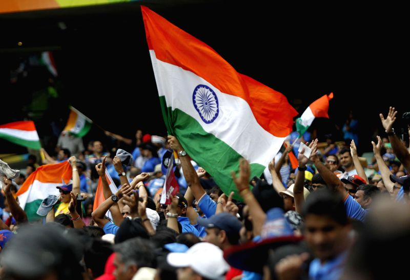 Indian fans wave the tricolour at the Melbourne Cricket Ground during an ICC World Cup 2015 match between India and South Africa in Melbourne, Australia on Feb 22, 2015.