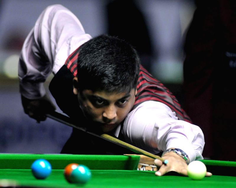 Indian player Brijesh Damani in action during IBSF World Snooker Championships at Kanteerava Stadium, in Bengaluru on Nov. 22, 2014.